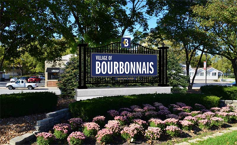village of bourbonnais sign with flowers and landscaping