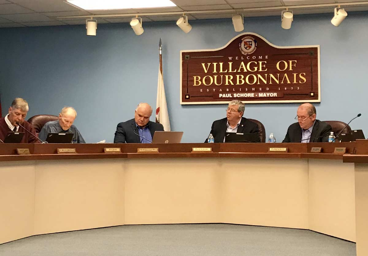 village of bourbonnais village board meeting inside administrative building with Mayor Paul Schore at the center