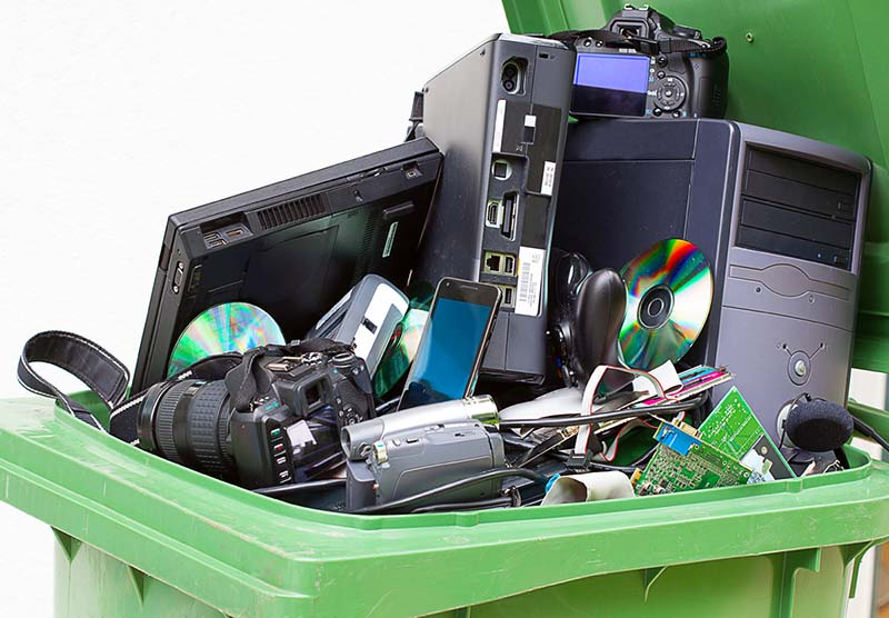 electronic waste/recyclables in garbage can
