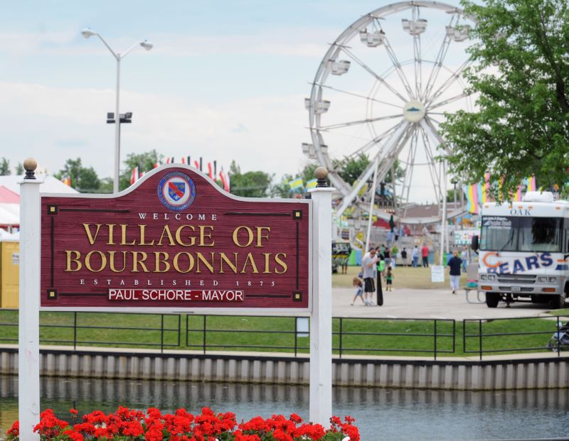 Welcome to Bourbonnais, Illinois sign outside in front of ferris wheel