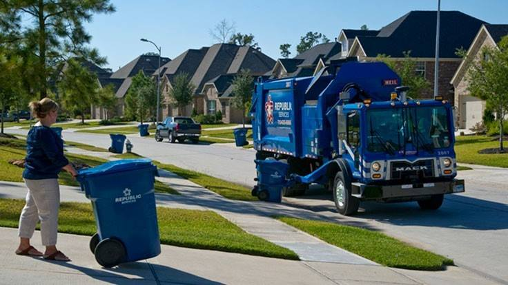 republic garbage truck during trash pickup with resident