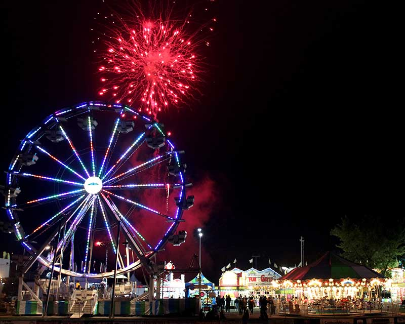 firework and ferris wheel at night during friendship festival