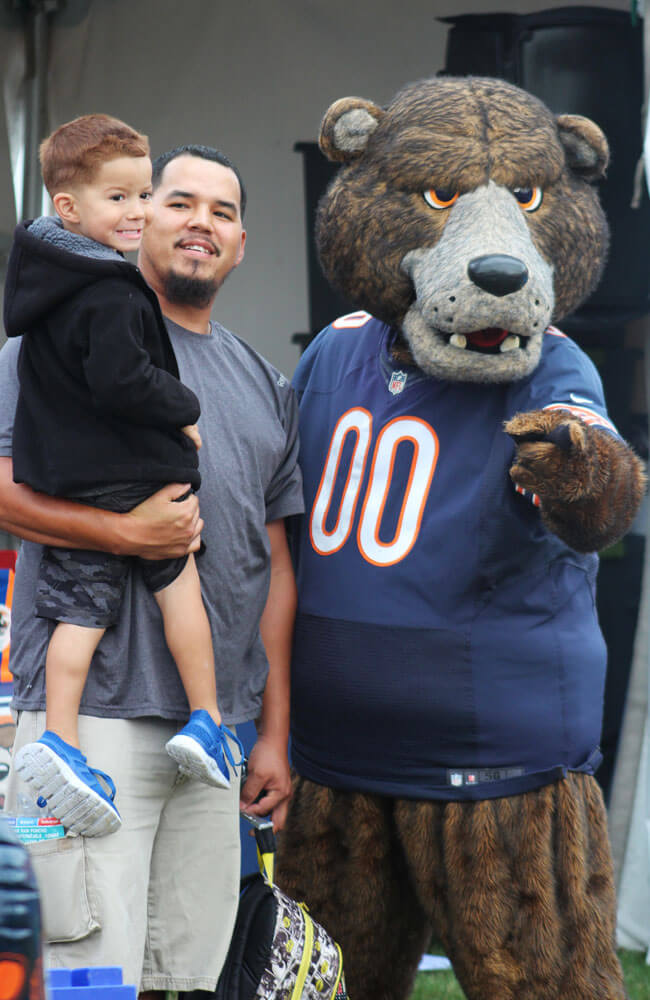 chicago bears mascot with dad and son during bears camp