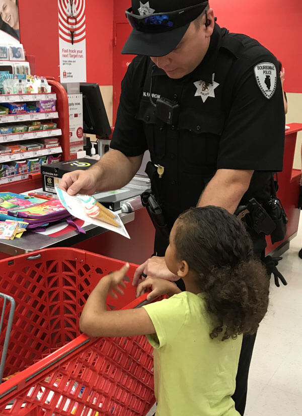 bourbonnais police officer with child during shop with a cop at target